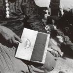 Navajo artisan carding the wool